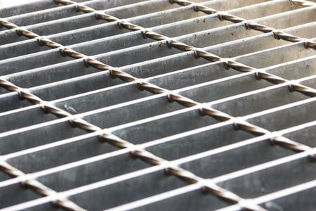 slip and fall on slippery sidewalk grate violated codes expert says