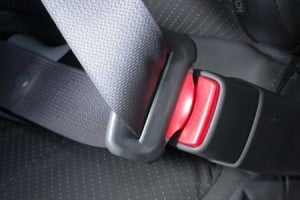 Defective Seat Belt Unlatched During Automotive Rollover Accident